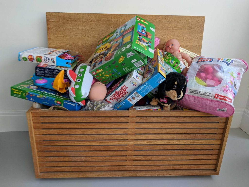 Toy box overflowing with kids toys